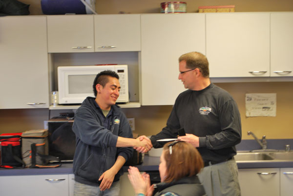 Mark Mortensen, All-Color President, recognizing Daniel for 5 years of service.